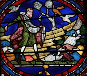 Medieval stained glass depicting the first scene of the Parable of the Sower, in which seeds scattered on stony ground are eaten by birds (Mt 13:3-5; Mk 4:3-5). Right panel in the fifth register of the Second Typological Window (n. XV, 19) in the north choir aisle, dated to about 1180. This was originally part of the Sixth Typological Window, which centered on the theme of seeds and the bread of the Eucharist.